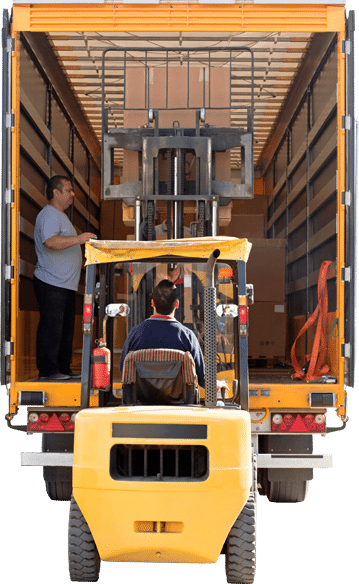 Worker loading boxes into the back of a moving truck using a forklift