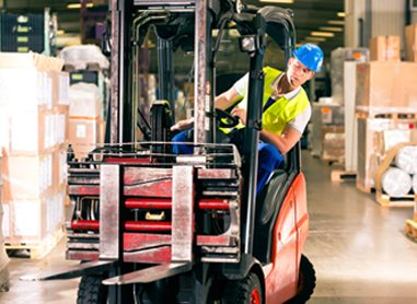 A man steering a forklift