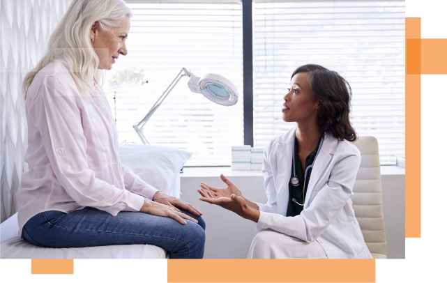 A doctor speaking to a patient about her vein treatments