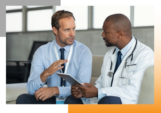 Marketer and physician talking over website performance