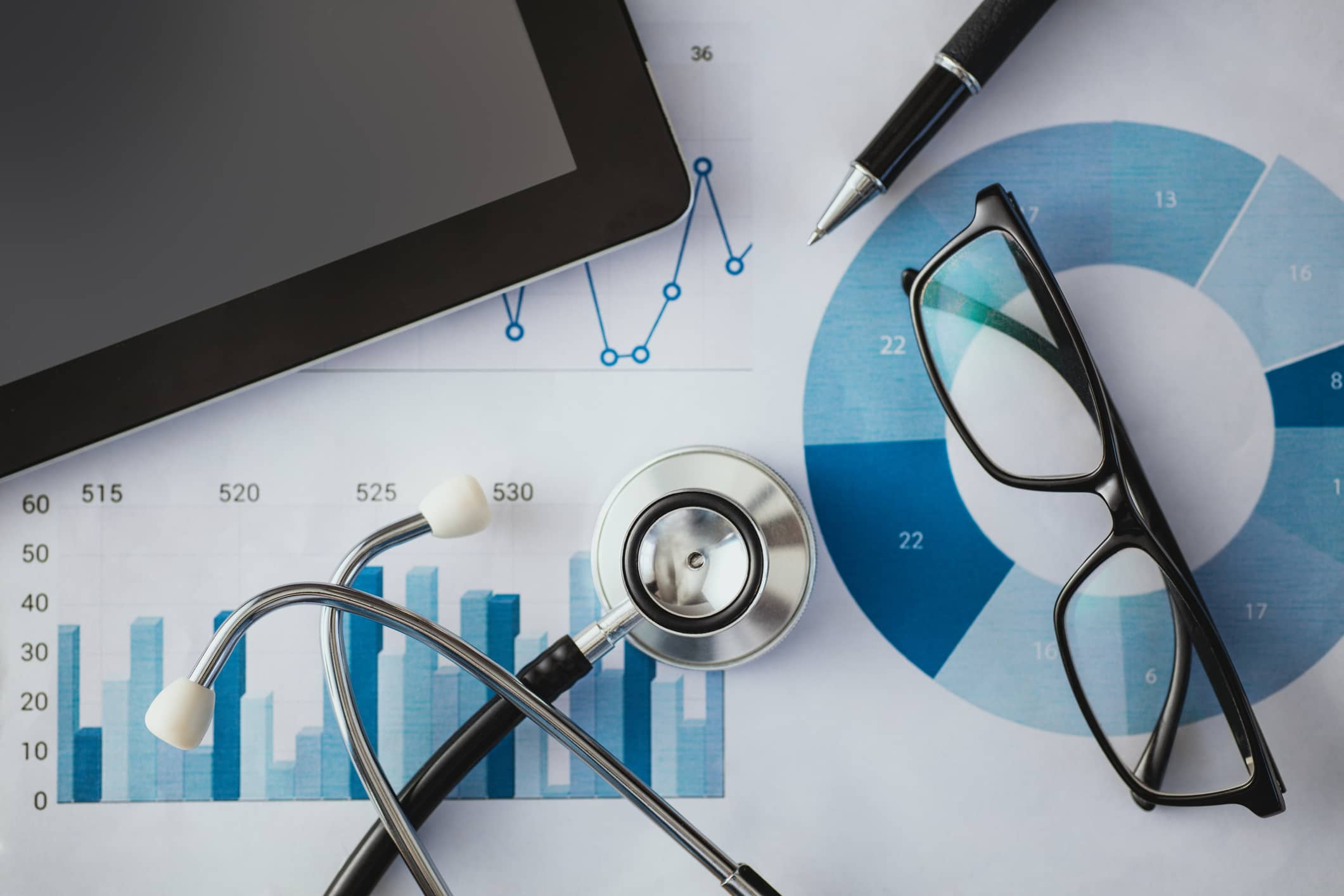 A stethoscope on a table with healthcare digital marketing strategies
