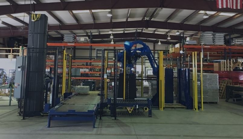 Blue robot integrated into warehouse
