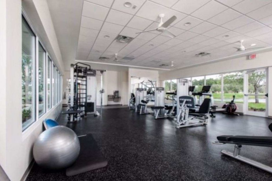 Room with Fitness Equipment and grey speckled tile floor