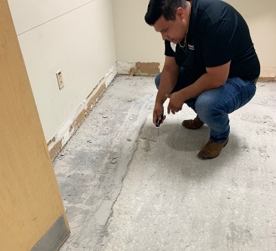 Justin Looking At A Concrete Subfloor