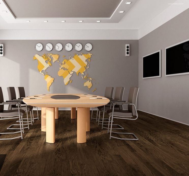 long view of conference room with light table and grey walls