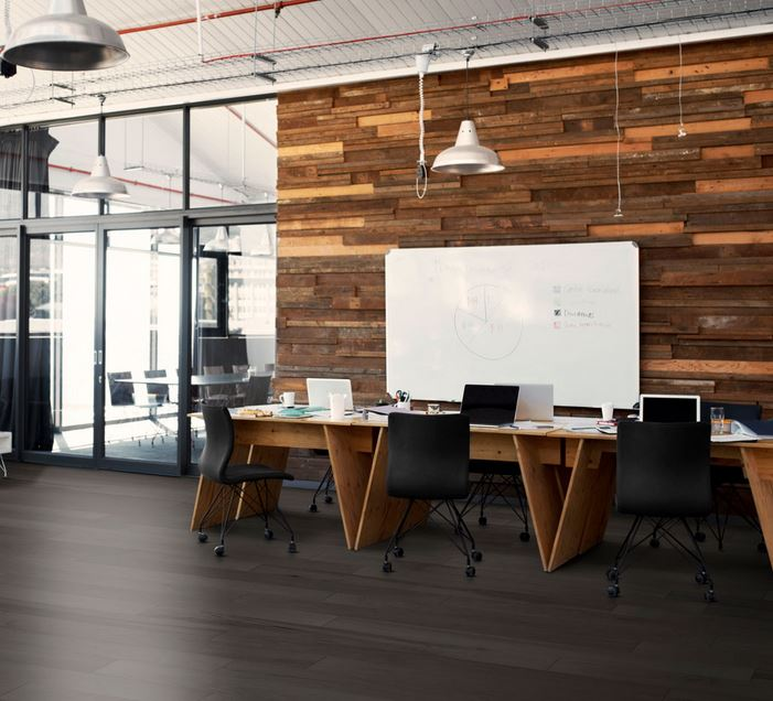 Dark wooden floors in office with wood paneled wall