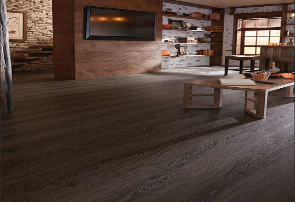 medium light wood flooring in a home with wooden walls