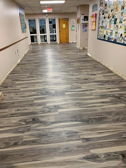 Hallway in building with wood grain floor