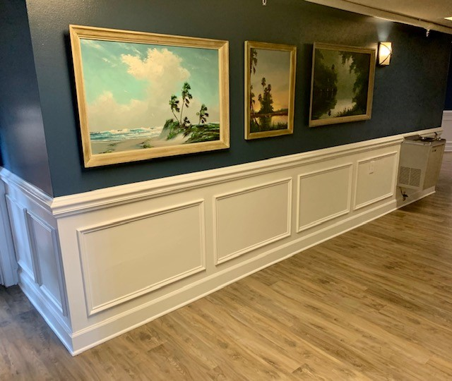 hallway with paintings on wall