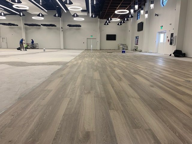 Flooring being installed in a large space