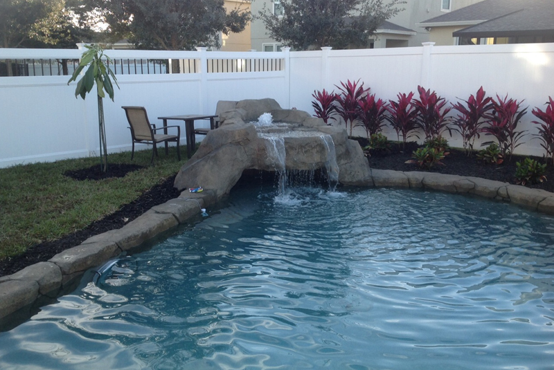 handcrafted natural pool in Orlando with a cave waterfall