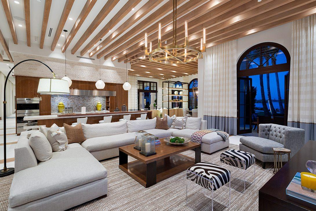 Living Room with Neutral Contemporary Interior Design and high ceilings and large candelabra