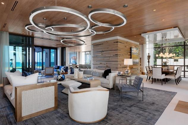 Luxury Modern Living Room Interior Design with circular art fixture and wood paneling