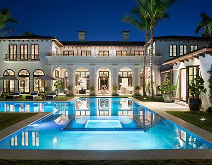 marc-michaels billionare's row luxury mansion with pool and palm trees