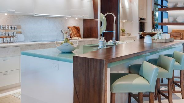 luxury kitchen island with pops of tiel