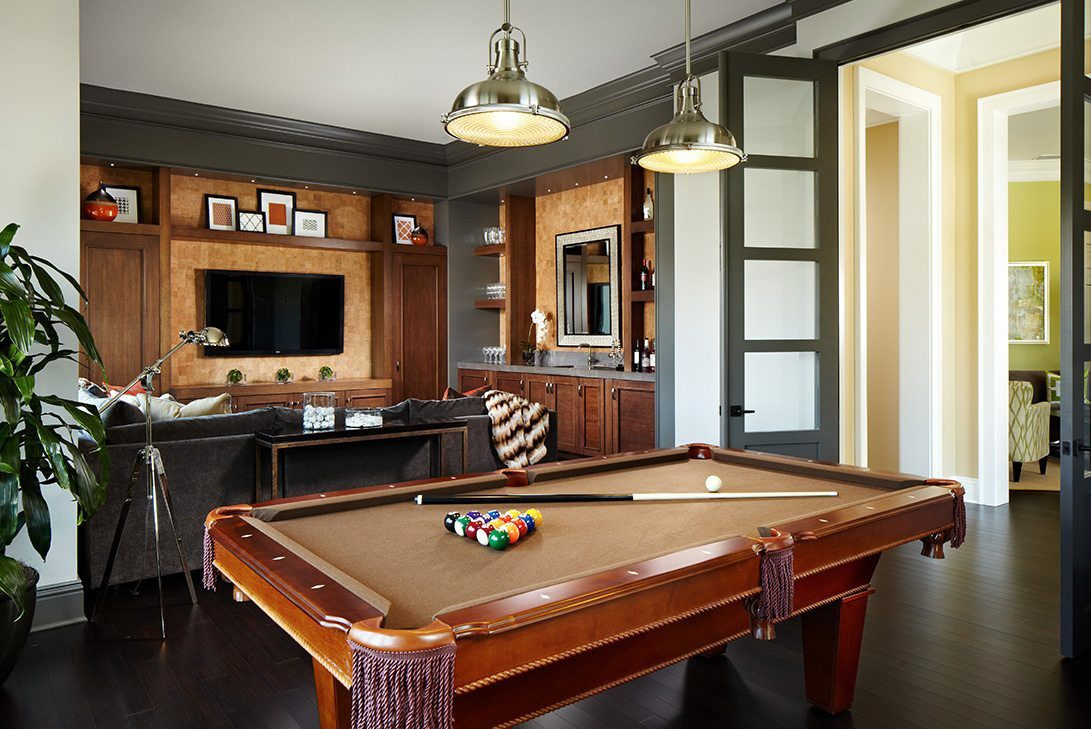 brown billiards table luxury game room with smart home lighting