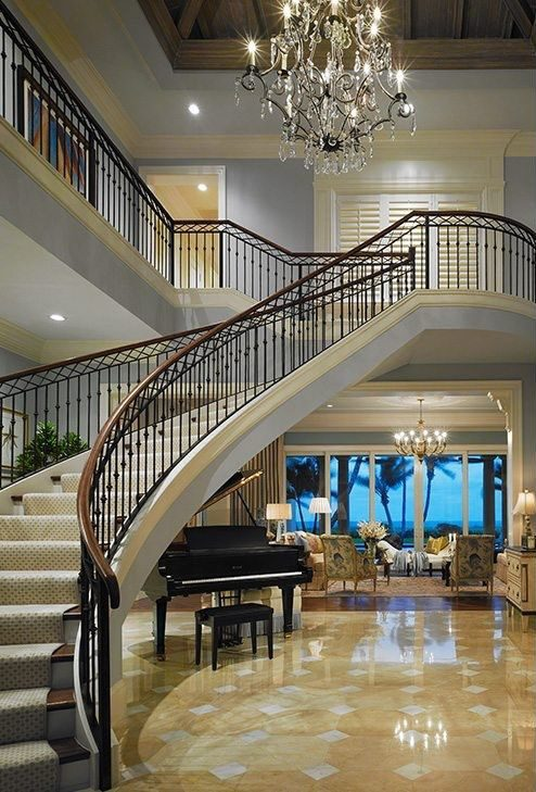 A luxurious grand foyer in a Palm Beach Traditional design project.