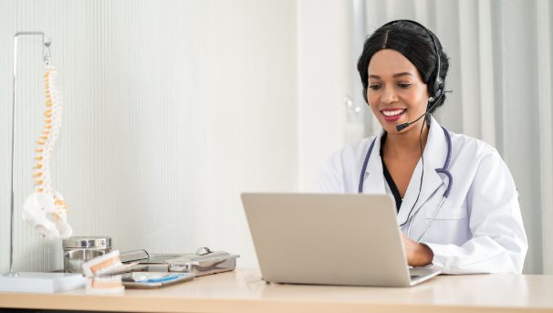 Doctor with Laptop and Headset