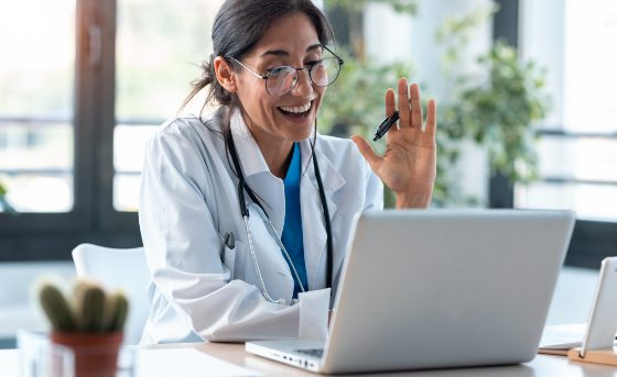 Doctor on Laptop with Patient